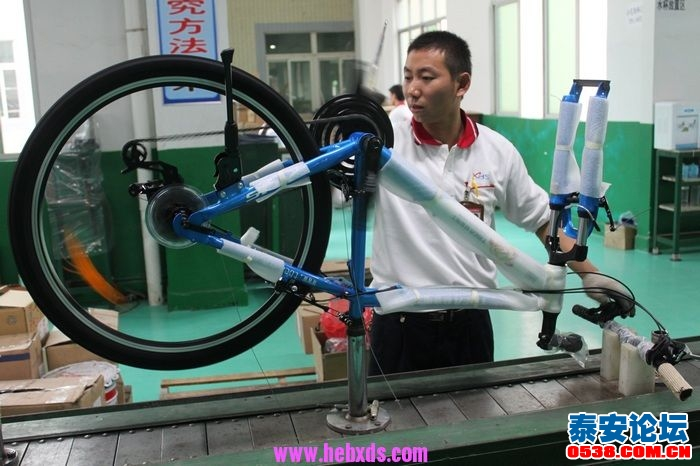 看自行车的生产加工过程,新泰特变电工版本山地自行车
